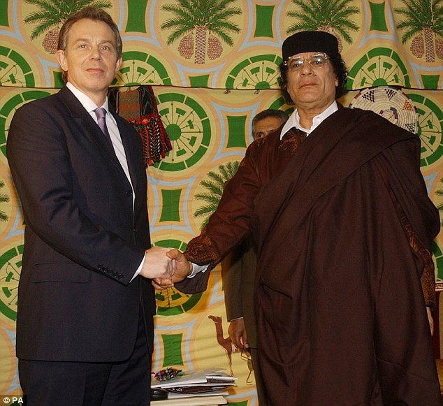 Accord: Tony Blair (left) shakes hands with Gaddafi in Tripoli. Just over two years later the dictator was dead