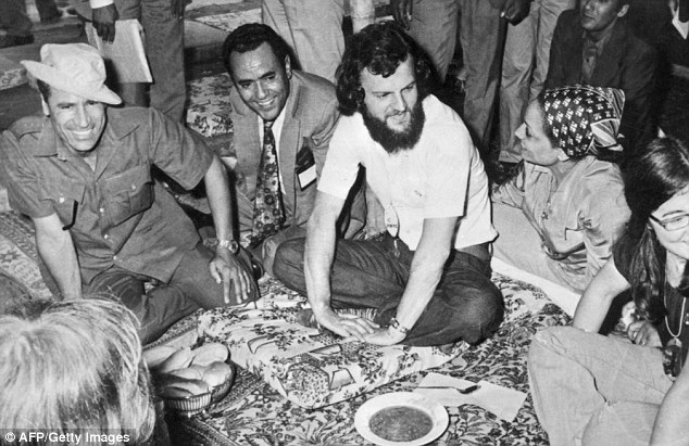 Gaddafi (centre) as a young man in 1973 shortly after seizing power. He was known to abduct women from their own wedding ceremonies as the ultimate show of omnipotence
