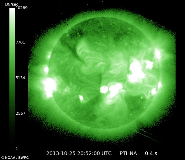 Burning up: The latest solar flare, on the sun's left side, was caught in this x-ray image