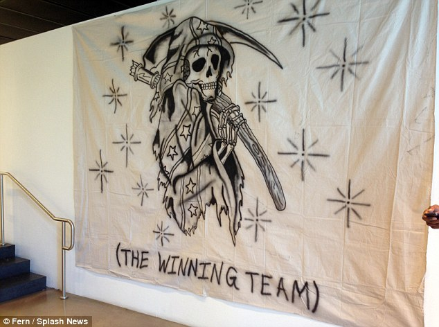 Dark: A skeletal grim reaper wears the confederate flag in a wall mural, the same image that is also featured on some of his T-shirts