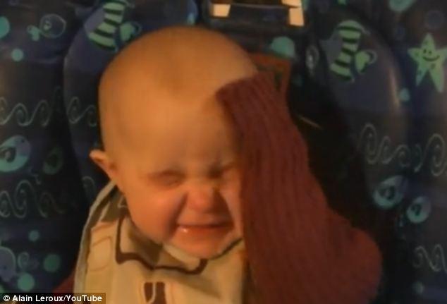 adorable baby goes through