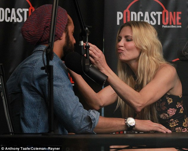 Pucker up: Brandi was seen puckering up to 'new friend' Drew Carter, whom she has been romantically linked to