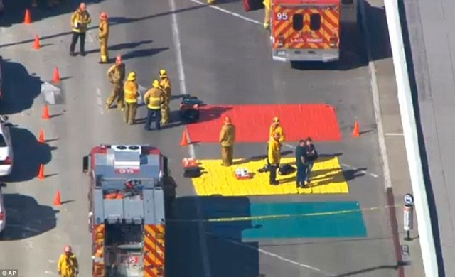 Fire and rescue personnel gather at Los Angeles International Airport on Friday after reports of multiple injuries following a shooting