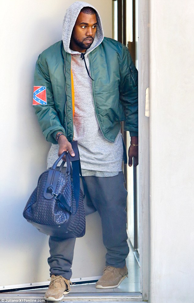 Defiant: Kanye West wore a jacket bearing the Confederate Flag as he left boxing class in Los Angeles on Saturday