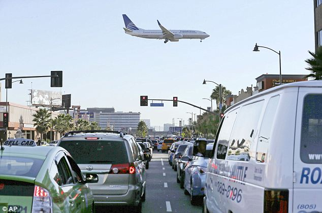Travel chaos at LAX as hundreds of flights are grounded and traffic grinds to a halt | Daily Mail Online