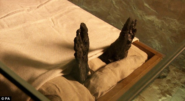 Engulfed: This picture shows the boy king's charred feet