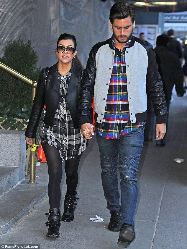 Kourtney Kardashian and Scott Disick wear matching plaid