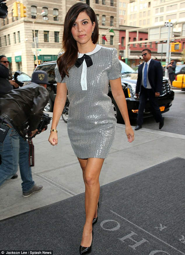 Dazzling: Kourtney Kardashian looked incredible in a shimmering slate dress in Manhattan on Wednesday