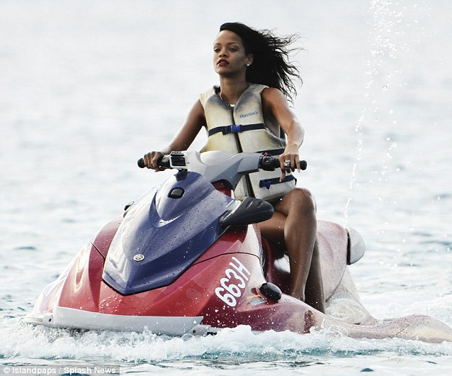 Safety first: The singer makes sure she puts on a life vest when speeding around on the jet ski