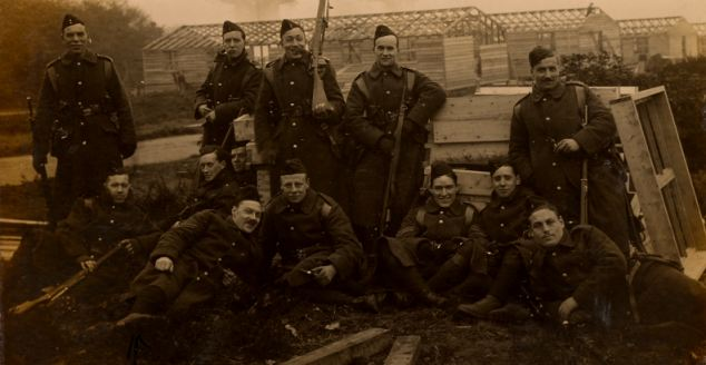 Brothers: William Hundy (far left) was killed by German fire, and was so badly disfigured that his own brother, Herbert Hundy (second left, standing with a pipe), did not realise who he was. Harry is second from the right in this photograph