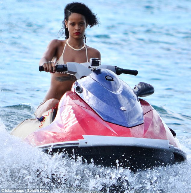 Shut up and drive: The songstress had the need for speed as she enjoyed her native Barbados