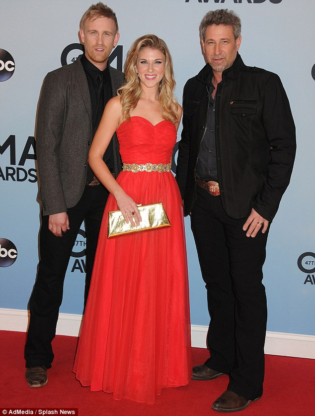American Beautiful: The Henningsens - Brian Henningsen, his son Aaron, and daughter Clara - are all smiles as they pose together on the carpet