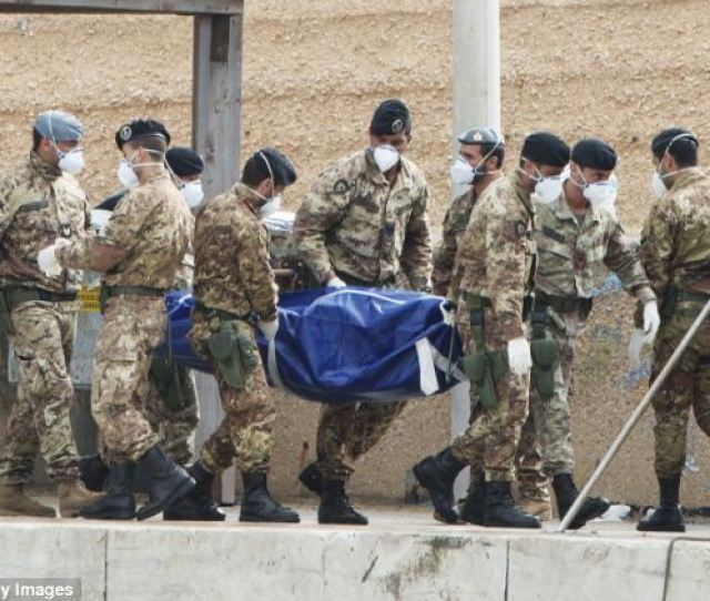 Grim Italian Soldiers Carrying The Body Of A Victim From The October  Shipwreck In