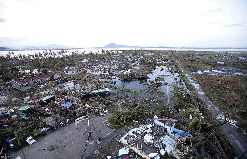 Desolation: This heartbreaking picture shows an flattened area of Tacloban city covered by debris and flood water