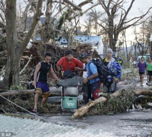 Residents try to seek shelter with their belongings following a