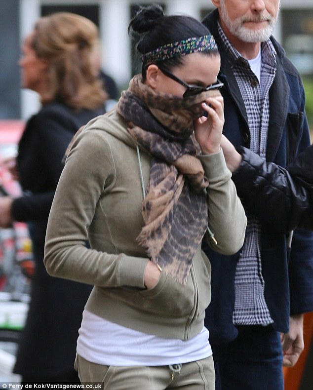 Under wraps: The 29-year-old Roar songstress hid her face with a scarf as she pounded the pavement
