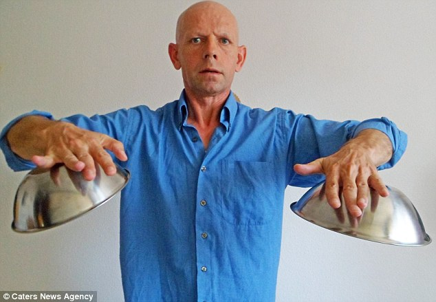 Magnetic personality: German psychic Miroslaw Magola claims to use telepathic powers to make metal stick to his body