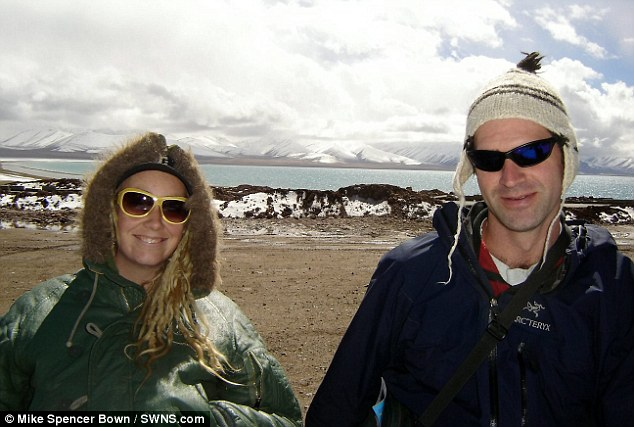 Mike Spencer Bown pictured with his friend Molly in Lake Namtso, Tibet. After 23 years of traveling he is finally going home