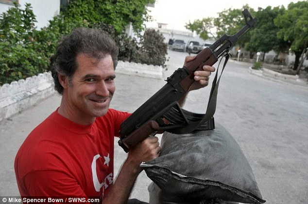 First tourist in Mogadishu: Mike in the Somalian capital posing with a gun