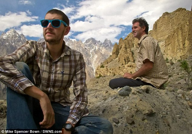 Mike Spencer Bown (right) pictured with a friend during a trip to Pakistan. He has spent the last two decades jetting across the globe