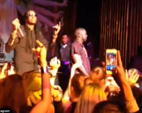 Celebration time: 2 Chainz and Kanye West take to the stage to give a birthday shout out to Leonardo