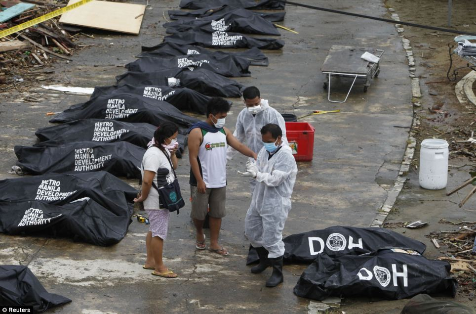 Victims: The bodies are just a tiny fraction of the death toll from the typhoon and agencies say mass graves are being filled with hundreds of people