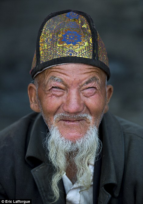 An elderly man pictured at a market in Keriya