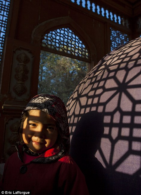 A little Uighur girl photographed in one of the region's mosques