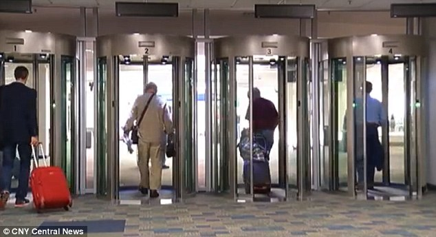 Beam me up! These new exit 'pods' have been put in place for passengers to pass through as they leave the baggage claim at Syracuse airport