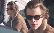 harry styles ties hair