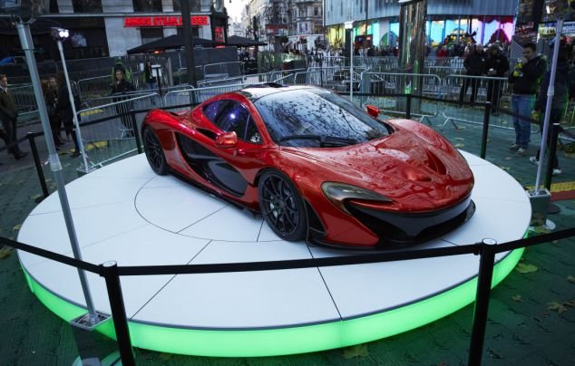 Flashy: Part of the set up features a sports car on a round stage. Around 500 retailers will start selling the new console at midnight
