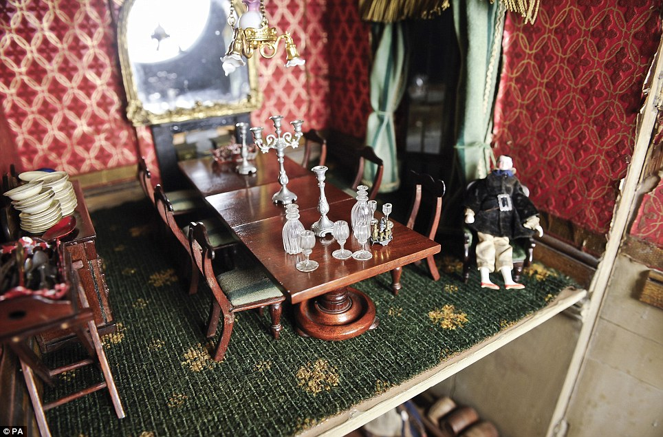 The dolls, china, utensils and some of the more elaborate furniture were produced in Switzerland and Germany at that time and were added to the doll's house during the family's holidays abroad