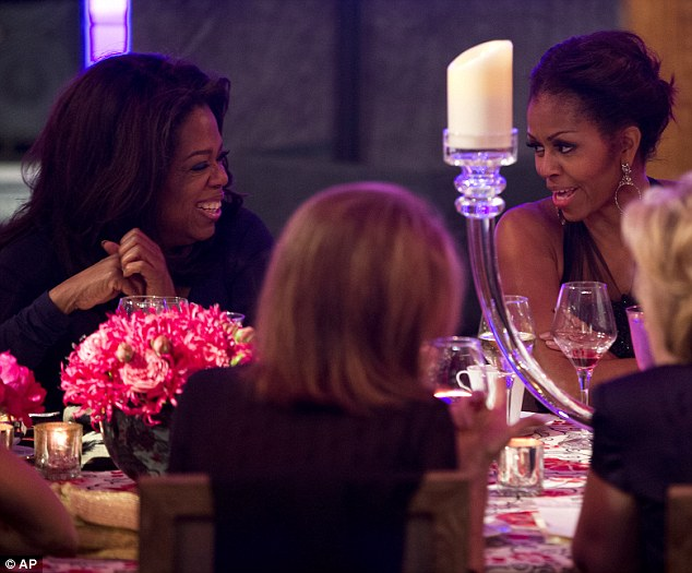 Social butterfly: The media mogul also had a good laugh with the First Lady Michelle Obama