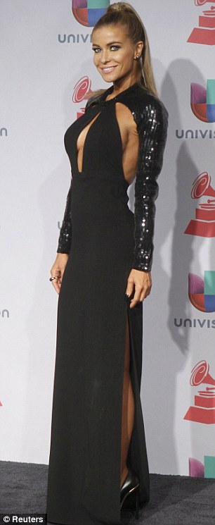Carmel Electra steals the show in flesh flashing backless dress slit to the thigh at Latin
