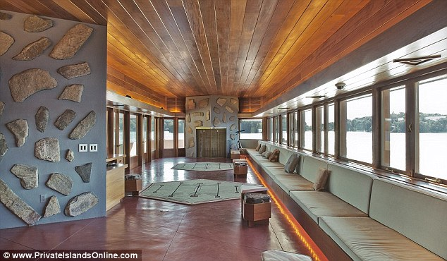 Stunning: The island's main house, designed by Frank Lloyd Wright and built in 2008, boasts ceilings panelled with the finest mahogany and breathtaking views of the surrounding area