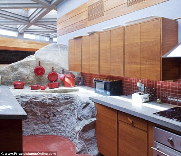 Anyone seen the rock salt? The kitchen juxtaposes new and old, marrying conventional fixtures and fittings with stylish work surfaces carved out of solid granite