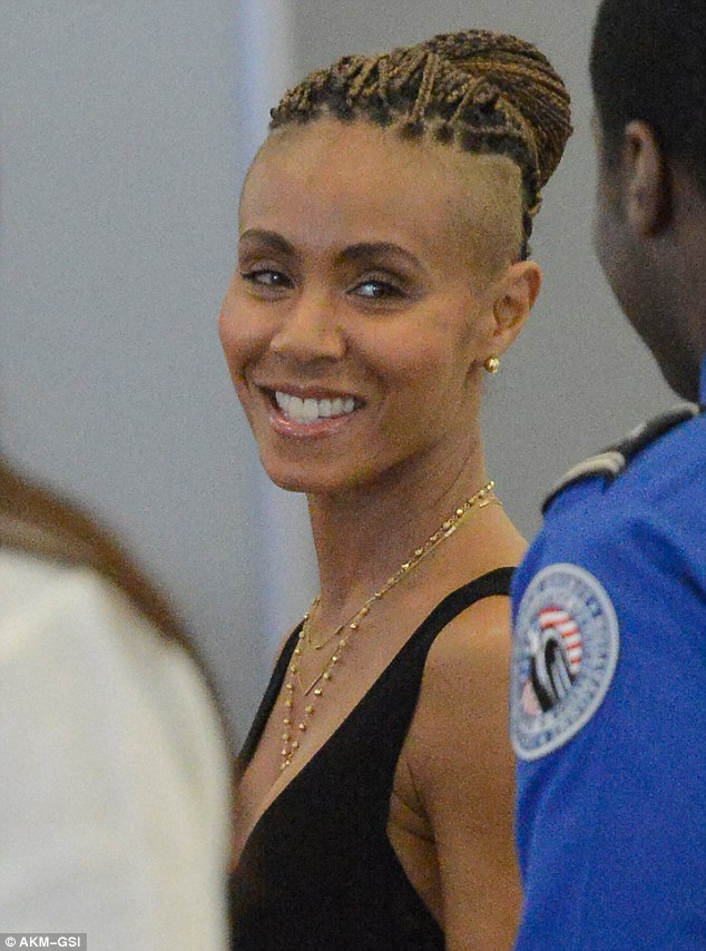 A knockout: The star shared a brilliant smile with one of the airport security guards