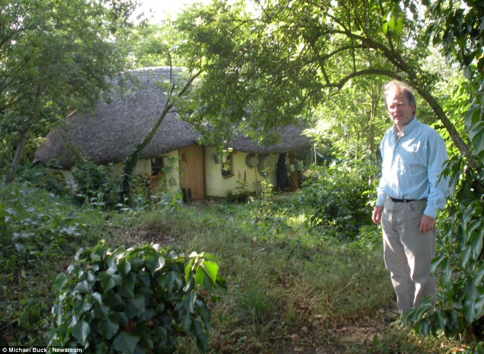 Resourceful: Mr Buck, pictured outside the cob house, said he wanted to challenge the notion that paying for a house should take a lifetime