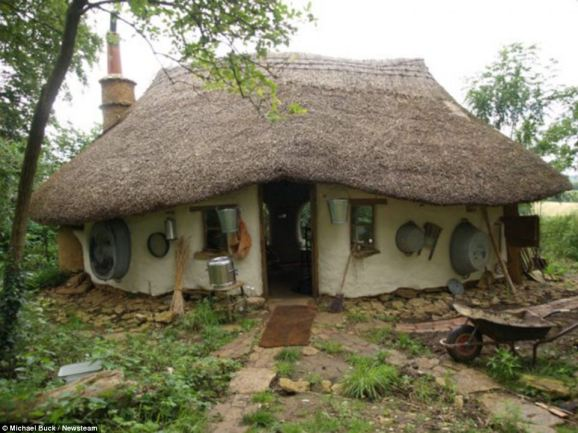 Cob house: Michael Buck built this house at the bottom of his garden for just £150 using natural or unwanted materials he found in skips