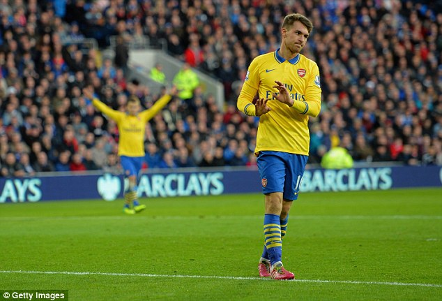 Muted celebration: Ramsey didn't go wild after breaking the deadlock and the Cardiff fans clapped him