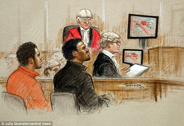 In the dock: Michael Adebolajo, 28, left, and Michael Adebowale, right, listen to evidence on the second day of their trial where witnesses said they had looked 'pure evil' and 'mad' when they allegedly murdered Lee Rigby
