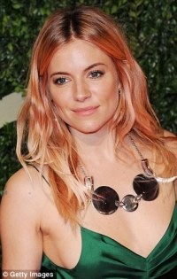 Sienna Miller dons emerald silk gown at British Fashion ...