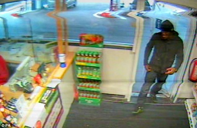 Adebolajo smiles as he pays for his petrol, hours before the attack on Mr Rigby