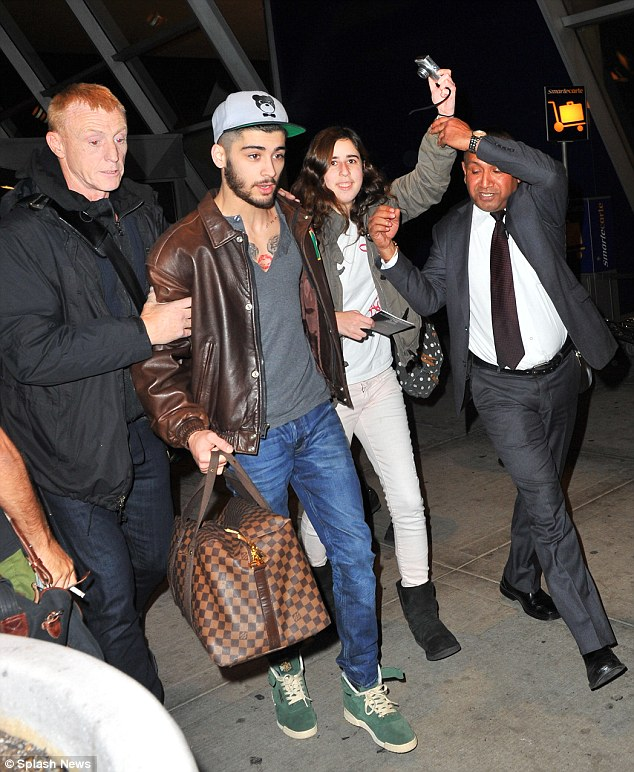 Just one picture: an eager fan tried to get close to Bradford boy Zayn but was held back by security