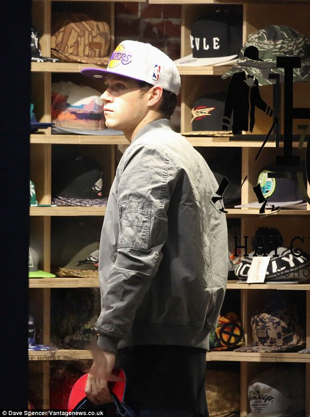 Niall Horan has trouble picking a baseball cap during a New York shopping spree  Daily Mail Online