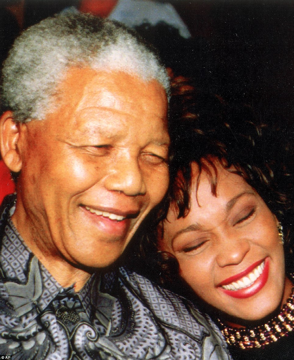 Late singer Whitney Houston cuddles up to Pres Nelson Mandela at the Union Buildings in Pretoria