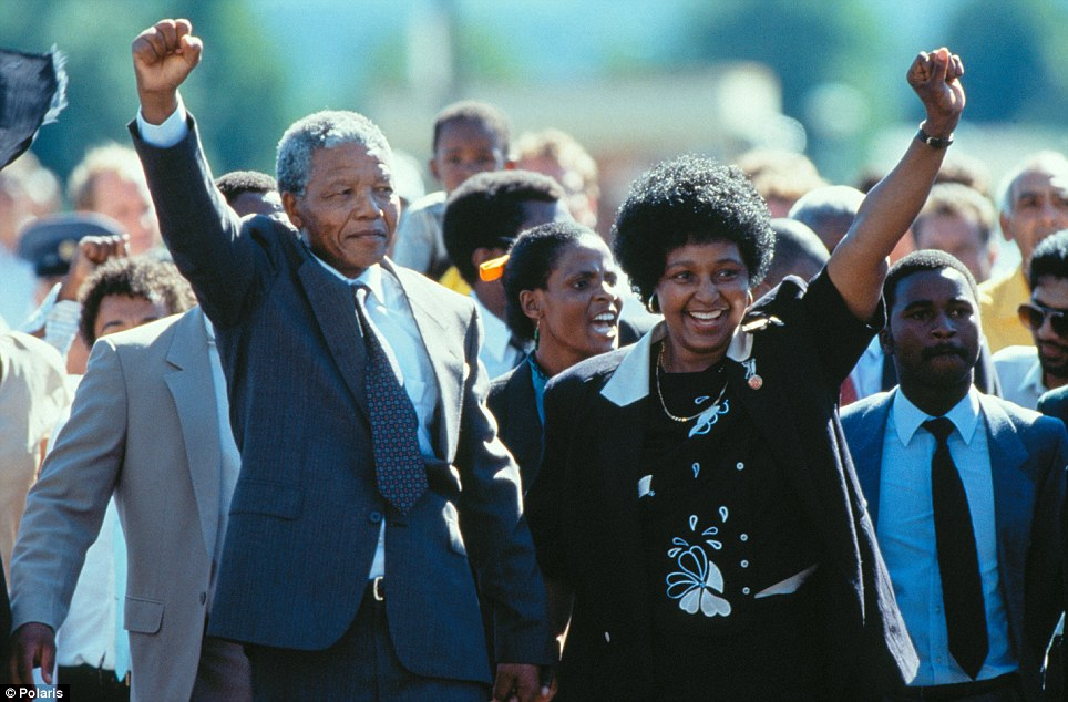 Accompanied by his wife Winnie and supporters, anti-apartheid fighter Nelson Mandela walks out of Victor Verster Prison near Cape Town, a free man after 26 years of imprisonment
