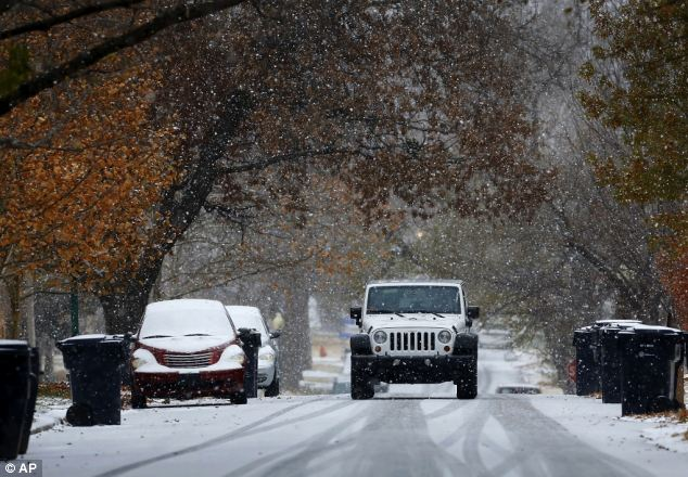 Frosting: Roads in this northwest Oklahoma City neighborhood had a light coating of snow by Thursday