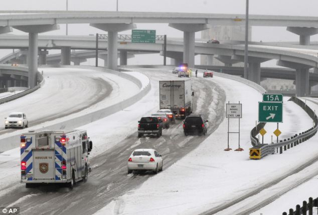 Slow moving: Motorists and emergency vehicles try to pass through snow and ice in Fort Worth
