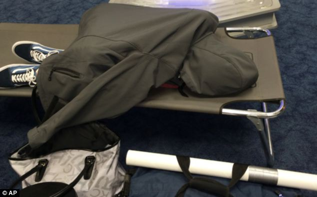 Grounded: An air traveler stranded at Dallas-Fort Worth International Airport sleeps during a flight delay